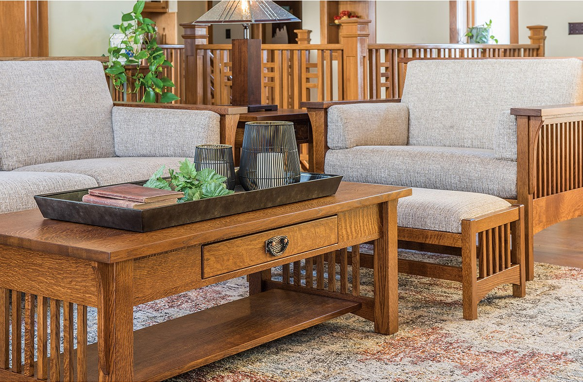 The Highback Slat Living Collection shown in Oak at Mattie Lu